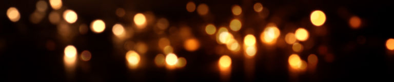 Festive sparkling lights and bokeh by night Stock Photos
