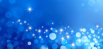 Festive sparkling lights. Shiny blue background in starlight and sparkles Stock Photos