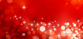 Festive sparkling lights. Shiny red background in starlight and sparkles Stock Images