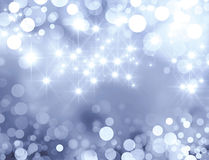 Festive sparkling lights. Shiny silver background in starlight and sparkles Royalty Free Stock Images