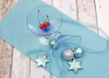 Festive spirit blue martini cocktail glasses on shabby chic table Royalty Free Stock Images