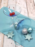 Festive spirit blue martini cocktail glasses on shabby chic - vertical Royalty Free Stock Images
