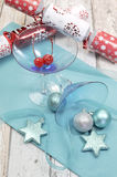 Festive spirit blue martini cocktail glasses w' Christmas decorations Stock Image