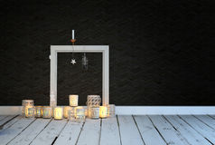Festive or spiritual background of burning candles. Festive or spiritual background of an arrangement of decorative glowing burning candles on a rustic white Stock Photo