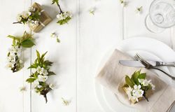 Festive spring table setting with pear blossom flowers Royalty Free Stock Photography