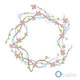 Festive spring wreath of dried twigs and small curved pink flowers Stock Photos