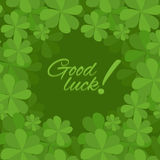 Festive square frame with a happy four-leaf clover. Postcard St. Patrick. Good luck Stock Photography