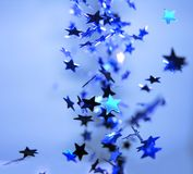 Falling Shiny Blue Stars Celebration Stock Photos