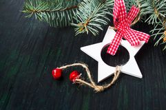 Festive decorations on dark background. Festive star shape decorations on dark wooden background Stock Image