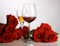 Festive still life. Still life with red roses, glasses and a candle Stock Photo