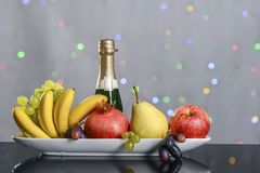 Festive still-life from fresh multicolored fruits on a beautiful background. Festive still-life from fresh multicolored fruits on a beautiful backgroundn Royalty Free Stock Photos