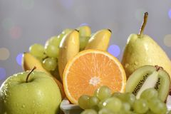 Festive still-life from fresh multicolored fruits on a beautiful background. Stock Images