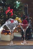 Festive still life with two cocktail glasses. Festive still life with Festive still life with two cocktail glasses with shiny red and silver Christmas-tree Royalty Free Stock Photos
