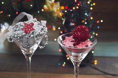 Festive still life with two cocktail glasses. Festive still life with Festive still life with two cocktail glasses with shiny red and silver Christmas-tree Stock Photography