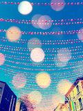 Festive street in gay neighborhood decorated with pink balls. With bokeh light effect. Annual summer installation in gay village on Ste-Catherine street Stock Photo