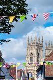 Festive Street view with York Minster towers in background in the historical city of York Royalty Free Stock Photography