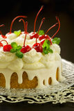 Festive sugar cake with coconut cream Royalty Free Stock Photography
