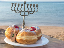 Festive sweet donuts with jam. Sweet donuts are traditional Jewish food for Hanukkah holiday Stock Images