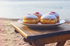Festive sweet donuts with jam Stock Photography