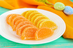 Festive sweets colorful jelly candies in the form of citrus slices, covered with sugar Stock Image