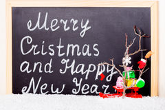 Festive symbols concept of decoration in snow on chalkboard back Royalty Free Stock Photo