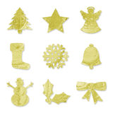 Festive Symbols - Gold. Festive symbols including a Christmas Tree, a Star, an Angel, a Stocking, a Snowflake, a Bell, a Snowman, Holly & a Ribbon/Bow Stock Photo