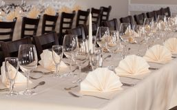 Festive table arrangement with glasses and served and cutlery Royalty Free Stock Image