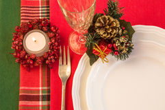Festive table with burning candle. Christmas theme. Royalty Free Stock Photography