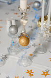 Festive table decorated with candles. In candlesticks of different colors and shapes. Crystal candlesticks on the table. Candle ball of gold and silver color Stock Image