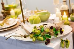 Festive table with candles and flowers closeup Stock Photos