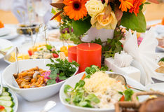 Festive table decorated with candles and flowers Stock Photos