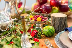 Festive table decorated with fruits closeup nobody. Festive table decorated with fruits closeup, nobody. Holiday celebration Stock Images
