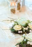 Festive table decoration in creamy white hues Stock Photography