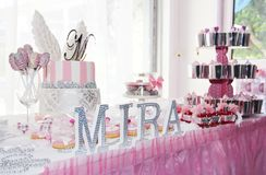 festive table decorations with cake, cupcakes, sweets and gifts in pink color royalty free stock photography