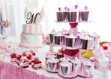 festive table decorations with cupcakes, sweets and gifts in pink color royalty free stock photos