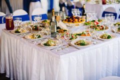 Festive table with food and empty glasses set for wedding Stock Photo