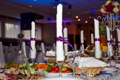 Festive table with food. And napkins in the glass Stock Images