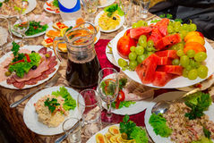 Festive table. With fruit, salads and cold meats. cutlery, crockery Royalty Free Stock Photos