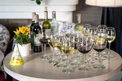 Festive table with glasses of wine, chilled bottles of wine stock images
