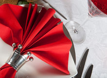 Festive table in red and white 8. Festive Christmas or wedding table with red napkins on a white tablecloth Stock Photography