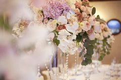 Wedding flower banquet decoration in tender color. Elegance of the wedding table decoration concept in the restaurant royalty free stock image