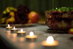 Festive table served treats and decorated with candles. stock image