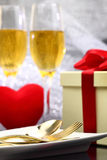 Festive table set with champagne Stock Photos