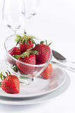 Festive table set with strawberry on white background. Strawberry in glass bowl for menu and invitation Royalty Free Stock Image