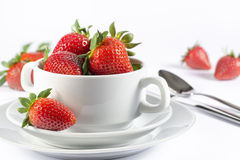 Festive table set with strawberry on white background side view. Fresh strawberry in white soup bowl for menu and invitation Royalty Free Stock Image
