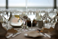 Festive table setting. With lots of wine glasses Royalty Free Stock Images