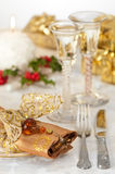 Festive Table Setting. Festive Christmas table setting with gold and red theme and antique wine glasses, selective focus on napkin jewel Royalty Free Stock Photos