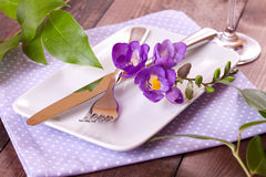 Festive table setting. Festive place setting with freesia Royalty Free Stock Photo