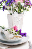 Festive table setting. And decoration with fresh flowers Stock Photos
