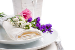 Festive table setting. And decoration with fresh flowers Stock Photo